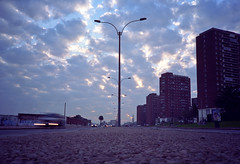 (patrickjoust) Tags: auto street city urban color building film lamp car night clouds analog america 35mm dark lens uruguay high focus automobile kodak dusk south patrick ground rangefinder olympus 100uc highrise manual montevideo xa rise expired joust range finder zuiko f28 compact rambla c41 ultracolor autaut patrickjoust