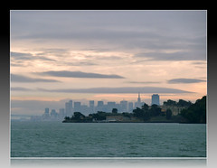 The Famous San Francisco Skyline (Morrow Cove) Tags: sanfrancisco city morning bridge pink sky usa water beautiful rain ferry skyline clouds buildings landscape bay scenery waves glow cityscape photographer unitedstates scenic overcast panasonic baybridge bayarea sanfranciscobay angelisland waterscape mygearandme zs7