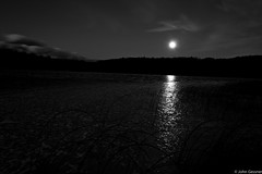Moon Rise (John A. Gessner Photography) Tags: longexposure blackandwhite bw moon lake ice clouds reflections photography frozen wideangle moonrise traversecity bandw northernmichigan canon1740mm 450d canonrebelxsi johnagessnerphotography