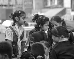 D7K 0665 ep (Eric.Parker) Tags: blackandwhite bw india monochrome children uniform delhi africanamerican schoolbus schoolkids rickshaw schoolgirls 2012 chandnichowk olddelhi 2011