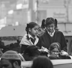 D7K 0675 ep (Eric.Parker) Tags: blackandwhite bw india monochrome children uniform delhi africanamerican schoolbus schoolkids rickshaw schoolgirls 2012 chandnichowk olddelhi 2011