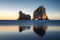 Archway Islands (loveexploring) Tags: longexposure sunset sea newzealand seascape reflection beach landscape island arch pacificocean southisland serene tasmansea westcoast seastack rockformation rockarch whararikibeach archwayislands