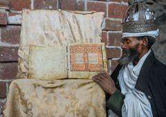 Ethiopian orthodox priest with an old bible in nakuto lab rock church, Amhara region, Lalibela, Ethiopia (Eric Lafforgue) Tags: africa people man color church horizontal silver religious reading book clothing day adult african faith religion monk christian unescoworldheritagesite holy indoors monastery devotion bible civilization crown priest christianity shawl spirituality ethiopia oneperson developingcountry gez lalibela engravings hornofafrica geez ethiopian eastafrica orthodoxchurch abyssinia manuscripts traditionalclothing realpeople cavechurch waistup adultonly onematuremanonly traveldestination 1people africanculture amhararegion ethio163793