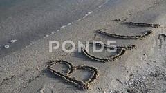 062776704-inscription-bali-sandy-beach (daria.boteva) Tags: ocean trip travel sea summer vacation bali tourism beach water sign closeup handwriting indonesia word island coast carved sand asia symbol drawing background space character sandy text free wave away nobody off card foam tropical letter destination coastline caribbean concept copyspace draw seashore caption inscription washes typescript
