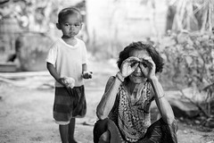 """Funny Face Woman with boy - Emerald Triangle, Isan (Sailing """"Footprints: Real to Reel"""" (Ronn ashore)) Tags: life people film rural countryside funny couple faces poor d76 manual manandwoman isan nikkormatft3 nikon50mmf14ais emeraldtriangle womenexpression rolleiretro100200"""