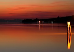 Waiting... (da.geli) Tags: sunset red italy lake black water island lights waiting umbria trasimeno doubleniceshot tripleniceshot mygearandme mygearandmepremium mygearandmebronze mygearandmesilver