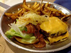 $12.99- AJ'S CLUB BURGER (a Double Bacon Cheeseburger with THE WORKS, Fried Onions, Chipotle Sauce on a Garlic Roll with Fries)