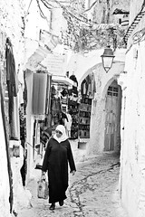 Chefchaouene (Umbreen Hafeez) Tags: life africa street woman white black face lady female walking mono alley african hijab morocco maroc chefchaouen moroccan chefchaouene