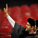 Faculty member Dr. Bill Hunt waves to family in the RBC Center crowd as he enters the arena.