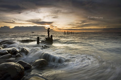 The Fisherman (Randi Ang) Tags: sunset seascape west beach canon indonesia landscape eos fisherman bravo 5d ang lombok pantai nusa randi barat tenggara ampenan exharbor