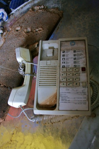 Abandoned telephone in cabana building