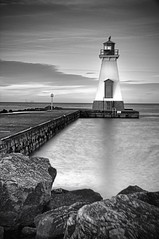 lighthouse in the evening (Jan Maklak Thank you for 25000 views) Tags: light bw lighthouse toronto reflection water evening pier rocks long exposure flat stcatharines hdr portdalhousie janmaklak