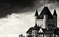 Thun Castle (Daniel Wildi Photography) Tags: blackandwhite lake storm castle monochrome sepia clouds vintage river switzerland thun schloss aar aare 2012 cantonbern danielwildiphotography