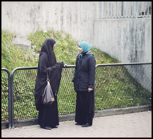 two women chatting while waiting for the tram