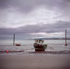(Jordan Woods) Tags: wood sky beach water clouds boat seaside sand fuji stones va 400 posts minehead rolleicord