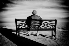 Excursion Into The Abyss (Melissa Bevins) Tags: sky people blackandwhite lake man reflection bench person thought emotion fineart