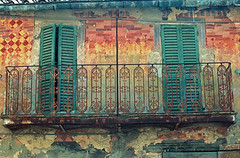 Painted wall weathered by time, Italy (ghoffman15) Tags: old italy art history horizontal wall facade paint balcony worn shutters weathered aged ironwork railing umbria torgiano