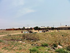 People queuing to fetch water at the borehole ...