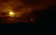 Sunset (Saturated Imagery) Tags: red silhouette 35mm fire iso200 epson praktica v500 filmslr vivitar28mmf25 prakticatl5b lomographyredscalexr devlopedthephotoshop