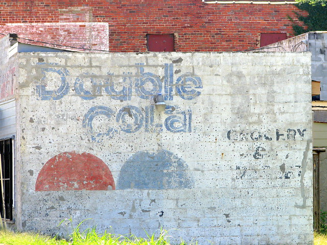 Double Cola faded wall ad.