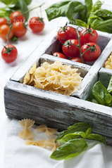 Raw italian pasta in the box (Oxana Denezhkina) Tags: wood red italy food macro cooking yellow closeup dinner tomato table lunch cuisine wooden healthy italian mediterranean raw background traditional group cook dry nobody pasta meal oil basil diet macaroni nutrition ingredient uncooked farfalle