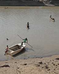 Crossing the Omo River (nicnac1000) Tags: africa beach ferry swimming swim river boats boat sand crossing mud transport canoe pole shore barefoot boating ethiopia crossed punt omo arbore ferried erbore snnpr