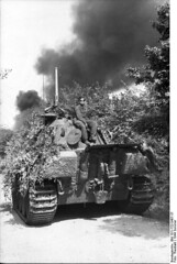 "France -. Camouflaged Panzer V ""Panther"" with armored soldiers. Black column of smoke in the background; KBZ OB West"