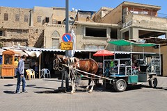 Street Life (Esther Spektor - Thanks for 10+ millions views..) Tags: road street people horse building window sign shop umbrella canon booth israel shadows carriage middleeast streetlife acre akko estherspektor