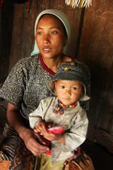Akha people in the village of Wan Pin, Shan state, Myanmar / Burma (sensaos) Tags: travel portrait woman baby asia child state burma mother tribal myanmar shan tribe motherhood birma indigenous azie shanstate akha azië birmese sensaos kalahumyaté