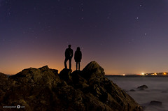 Alone in the dark - [EXPLORED] (andreaskoeberl) Tags: ocean california longexposure two people water silhouette northerncalifornia night dark stars coast monterey lowlight nikon couple rocks glow pacific illuminated pebblebeach 1020 sigma1020 d7000 nikond7000 andreaskoeberl
