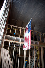 Flyin' the flag. (EyePulp) Tags: brick illinois construction unitedstates interior object plumbing insulation location structure manmade framing electrical studs 2x4 lumber remodeling naturalgas towanda gaspipe churchhome closedcellfoam