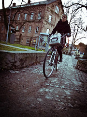 Balance (Klardrommar) Tags: street school woman lund sol bike bicycle digital photography university sweden balance gr sverige centrum ricoh sprk litteratur grdii