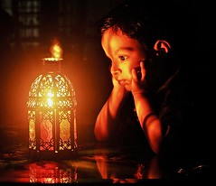 (Ferdousi.) Tags: light boy reflection lowlight candlelight bangladesh chittagong ferdousi arhaam nikond300s childrenarespecial