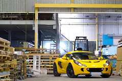 Exige (Clment | www.carbonphoto.fr) Tags: auto light car yellow colin jaune nikon automobile factory lotus automotive voiture coche nikkor supercar usine spoiler chapman exige sportcar entrepot worldcars d300s lightisright
