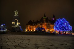 The lights of Confederation Square (beyondhue) Tags: christmas sky ontario canada night dark square lights memorial war downtown pavement ottawa dry wellington elgin laurier fairmont confederation chteau beyondhue