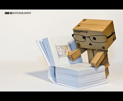 Danbo reads (YV.Photography) Tags: toy book flash danbo 420ex 50f14 canon60d revoltechdanbo