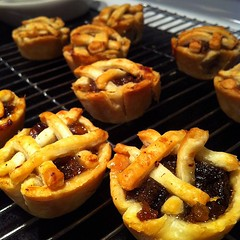 Taking tiny tiny mince pies out of the oven.