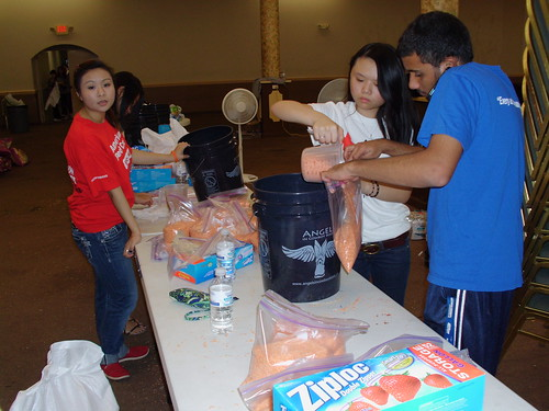 Alliance volunteers in Houston filling AICB buckets for flood affected families in Sinhd Pakistan    (95)