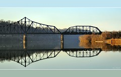 Ohio Crossing at Beaver (Images by A.J.) Tags: railroad morning bridge ohio reflection water glass train sunrise river tren dawn mirror golden pittsburgh pennsylvania steel smooth rail railway trains beaver pa hour bahn treno freight chemin placid trein csx ferrocarril truss  ferroviario csxt   ferroviaire