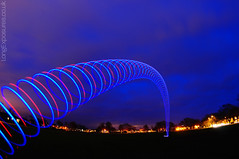 Blue Monday (AndWhyNot) Tags: light lightpainting art painting spiral wire spin el landing slinky coil 9569