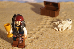 Captain Jack Finds The Treasure (Fizikal Rex) Tags: toy sand treasure lego odc captainjacksparrow