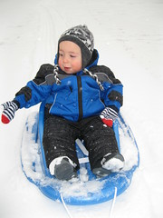 Day 12 - First snow! (Karin Beil) Tags: winter snow toddler grandson blake sled