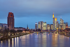 Frankfurt Skyline (Philipp Klinger Photography) Tags: longexposure bridge blue trees light urban orange reflection tree water yellow skyline architecture night skyscraper canon reflections river germany stars deutschland lights star evening am europe long exposure european cityscape hessen slow main tripod central bank hour shut
