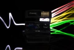 The dark side of Polaroid (Daniel de Oliveira Pereira) Tags: pink light moon dark painting polaroid side mm 50 2012 the floy d80