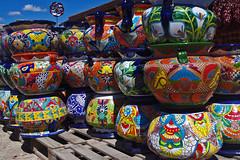 Mexican pottery.  Camino Real Imports and Gift Shop, Taos, New Mexico. (cbrozek21) Tags: newmexico folkart pots taos maxico mexicanpottery paintedpottery colorfulpottery colorsinourworld