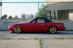 Cameron Harris's NA Miata (Greater East Imports) Tags: red na static 18 mazda miata slammed softtop lowed goldrims midpipe fronttip