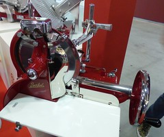 Berkel hand operated precision meat slicers - restored. I want one for my dining room - the colour suits too! (tedesco57) Tags: hand exhibition restored slicer cibus