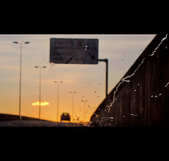 Canido Way (RL Mulholland) Tags: road travel viaje light sunset espaa orange color colour luz car rain silhouette yellow composition canon evening interesting spain explore coche pointandshoot windshield ontheroad ferrol acorua gallego caretera explored canonpowershots95