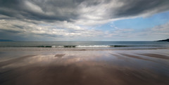 a silence louder than words (Dove*) Tags: reflection beach clouds scotland wave