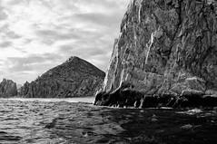 Rocks at Land's End (David's_silvershots) Tags: bw cliff beach mexico scary cabo fuji conversion rangefinder cliffs landsend finepix fujifilm nik fujinon cabosanlucas seasick x100 roughocean silverefex